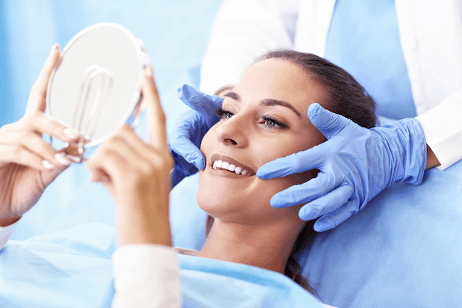 Woman smiling after getting dental implants at Henderson Oral Surgery & Dental Implant Center in Henderson, NV